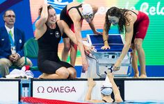 Sandrine Mainville, Chantal Van Landeghem, Taylor Ruck, and Penny Oleksiak celebrate winning bronze in the Women's swimming 4 x 100m…