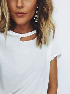 Keepin' it comfy in this Anine Bing white destroyed tee! You can find the exact one here (only mediums and larges are left I think), or similar ones below! These earrings I love pairing with a plain tee to add …