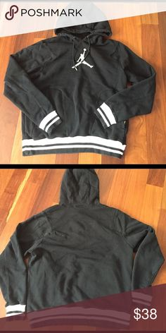 jordan hoody black with a some white pullover Jordan hoody. pockets on side with zipper. worn a few times but in great condition, it's a men's medium but it fits as a women's medium as well. Jordan Sweaters Crewneck