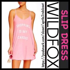 "❗️1-HOUR SALE❗️WILDFOX  'Shopping Is My Cardia' WILDFOX Slip Dress 'Shopping Is My Cardio'   NEW WITH TAGS  RETAIL: $78  * A subtly relaxed fit & A-line silhouette  * Incredibly soft & comfortable  * Graphic detail on front w/a subtly distressed look * About 33.5"" long   * A scoop neckline & thin straps  Fabric: 100% Cotton; Machine wash, Made in the USA Color: Neon Sign Pink Item: WF819   No Trades/PAYPAL ✅ Offers Considered*✅ ✅ Bundle Discounts  ✅ Wildfox Dresses Mini"