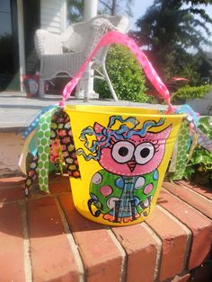 paint a pail, add towel, sunscreen and beach toys for a cute summertime gift!