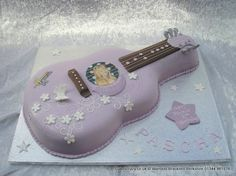 Hannah Montana smaller guitar shaped cake in lilac with butterfly and flower decoration  http://www.cakescrazy.co.uk/details/hannah-montana-guitar-cake.html