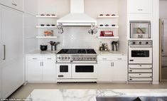 Perfect for hosting! There is an all-white chef¿s catering kitchen with two fridges, four ...