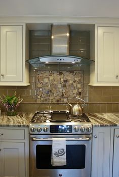 Brown Fantasy Leathered quartzite countertops with white cabinets and a glass tile backsplash - Kitchen by Stoneshop from Cherry Hill, NJ. Backsplash Kitchen White Cabinets, Cheap Kitchen Cabinets, Granite Kitchen, Backsplash Tile, Backsplash Ideas, Ikea Kitchen Design, Small Kitchen Layouts, Kitchen Decor, Kitchen Ideas