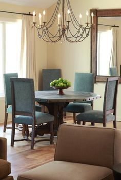 love the chairs and table - the chandelier I would replace with something like branches, twigs and crystal