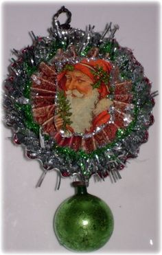 First ornament of Christmas 2011..next one will be better. made from a tart tin..fun!!.. :)