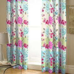 Curtains with a pencil pleat header.