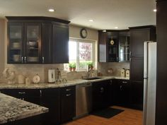 Similar to how we are re-doing our kitchen... same color cabinets with a similar design. Very similar granite counter tops... only difference is the floor will be tile.