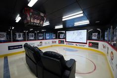 Ultimate hockey man cave. - My husband saw this and made me pin it. :P  I think this is a YES for our future home.