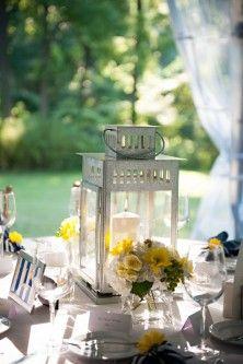 Lantern Wedding Centerpieces - cute to add 1 or 2 tiny glass vases next to lantern