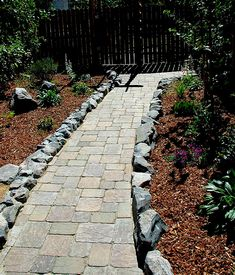 Regular pavers in random pattern - larger pavers than most, with rough rock edging (you would have cobblestone edging) Stamped Concrete Walkway, Paver Walkway, Walkway Ideas, Landscaping A Slope, Landscaping With Rocks, Landscaping Ideas, Garden Edging, Garden Paths, Walkway Garden