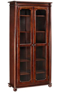 Cherry-finish bookshelf with glass doors, assemble yourself -- for storing/displaying glassware.
