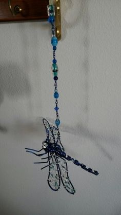 Dragonfly sun catcher with swivel so it can spin in the breeze. Wire wrapped beaded.