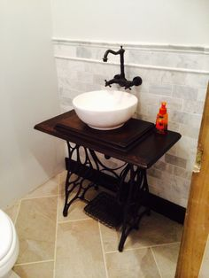 bathroom vanity made from antique sewing machine