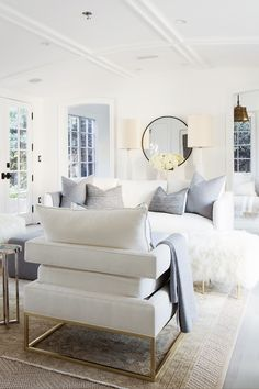 Light and bright all-white living room with touches of brass and dove gray.