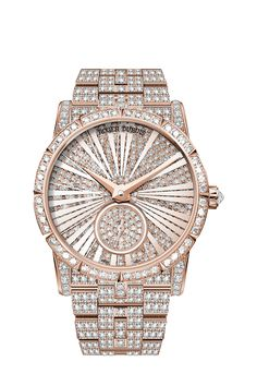 """Roger DUBUIS-Haute Joaillerie-This exclusive and precious creation is fully paved with more than 11 carats of brilliant‑cut diamonds. This must‑have for Haute Joaillerie lovers and Fine Watchmaking connoisseurs features a double sapphire crystal: one carrying the metallised Roman numerals and protecting the diamond‑paved dial, and the second encasing the hand and """"sealing"""" the timepiece."""