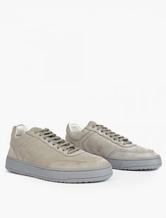 ETQ Amsterdam | Grey Low 5 Sneakers | With an emphasis on high-quality and considered design, ETQ Amsterdam craft premium sneakers to the highest standard using traditional shoemaking techniques. As one of the brand's signature styles, these low-top 5 sneakers offer a luxurious contemporary take on a classic athletic silhouette. They are finished with a lace-up closure and a rubber cup sole.