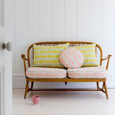 Pastel pink and yellow cushions for a wooden bench and chair | The Relaxed Home blog