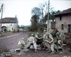 Members from the 607th Tank Destroyer Battalion (attached to the 95th Infantry Division) load their 3 inch M5 anti-tank gun on one of the approaches to Metz.