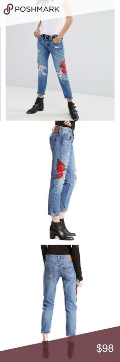 "Levi's 501 Rose Embroidered Cropped Taper Jeans 100% cotton distressed jeans (intentional holes); Cropped length, tapered at ankles. Button fly with metal shanks, 5 pocket styling. Red rose embroidery along thighs. When flat, waist measures approx. 15 3/4"" across; front rise approx. 10"" and inseam approx. 26"" Levi's Jeans Ankle & Cropped"