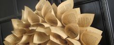 This paper wreath made from a book is giving me ideas.