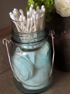 DIY blue mason jar, with cotton pad storage at the bottom and a votive holder in the top for q-tips. Brilliant idea!
