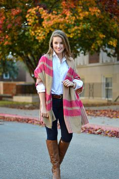white oxford cloth shirt + plaid blanket cape + dark skinny jeans + cognac boots