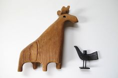 A wooden moose toy, Canada, 1960s, maker unknown, alongside a modern miniature bird by Swedish design company Bengt & Lotta.  From the collection of Belinda Esperson.