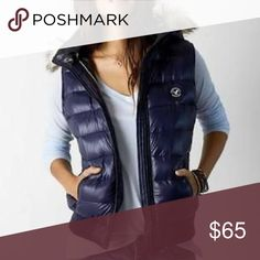 American Eagle Outfitters Blue Puffer Vest AEO blue puffer vest with faux fur hood. American Eagle Outfitters Jackets & Coats Vests