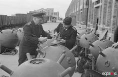 German armorers fuse sea mines at unidentified French seaport to get them ready for deployment.