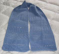 This is my Advent scarf from 2011 which is a sampler of mostly texture based stitches, although there is some lace. There are 24 patterns in all and the scarf is about 7 1/2 wide by 86 inches long. I used a sportweight yarn, but a fingering weight would yield a narrower and shorter scarf and likewise a heavier yarn would create a longer and wider scarf. I used about 600 yds of Elsebeth Lavold Silky Wool for the prototype. The scarf pictured though used Queesland Joey's Baby Silk.