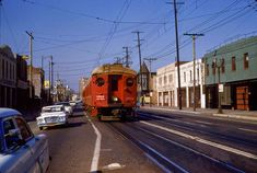 The Pacific Electric Railway was a large interurban that served the Los Angeles region.  Heavily dependent on passenger traffic what remained of the PE disappeared into SP in 1965.