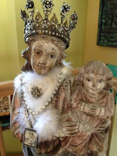 My lovely Madonna & Child statue dressed up in beautiful jewels, feather boa & dreamy crown.