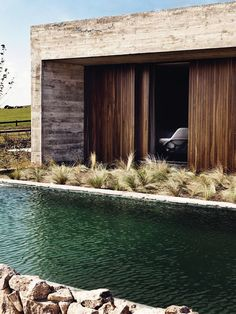 contemporary weekend house, concrete, wood, grasses, pool, mix of materials, Isay Weinfeld architecture