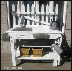 beautiful potting bench created from a gate, drawer and old window. via Homeroad by leticia