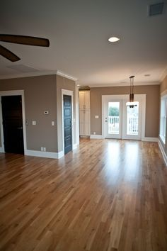 Looks like the main level of my house. My colour is very close on walls and wood floor. My paint was CIL Glidden in Tomorrow's Taupe and trim and crown moulding in Kitten White. :-) My accent wall is Renoir Bisque.