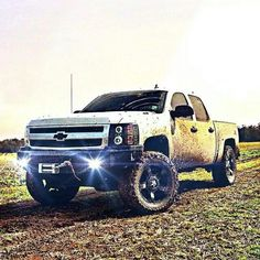 lifted white Chevrolet Silverado nice tires