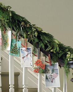I like this, hanging cards on ribbon on the stairs