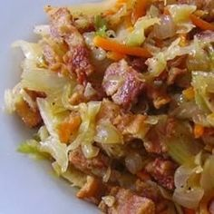 Fried Cabbage with Bacon, Onion, and Garlic - This is a family favorite that is put into every cookbook for my kids when they move out and get married. It is a beautiful dish with many colors and full of flavor. Warning, it is addictive!