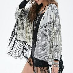 Fringe kimono So cute, worn once but I have too many kimonos! Natural and black. Forever 21 Tops
