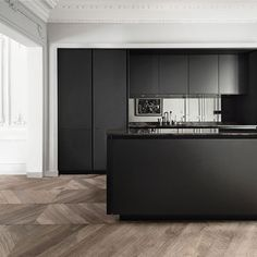 This 'Pure' kitchen  by Siematic is so pared-back that, in spite of the design's crisp, modern lines, it still blends seamlessly with the beautiful period details of this historic Parisian apartment. A matt-black lacquer finish on the fronts and a mirrored splashback keep things cutting-edge but classy. 'Pure' kitchen, from £30,000, Siematic (siematic.co.uk) Photography: Claus Brechenmacher & Reiner Brau