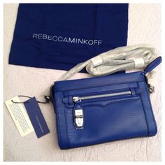 """Rebecca Minkoff Mini Crosby Crossbody Brand new with tags! Rebecca Minkoff Mini Crosby Leather Crossbody bag in Majorca Blue with silver hardware. Chain strap is adjustable & bag can be worn as a crossbody (21"""" drop) or a shoulder bag (14"""" drop when doubled). Bag features a top zip closure, one exterior front zipper pocket with turn lock and an exterior back pocket. Perfectly sized to fit all your essentials for the day or a night out! Bag size is 8.75""""x6.5""""x2.25"""". Dust bag included. Rebecca…"""
