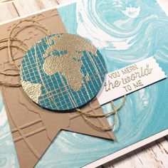 Stampin' Up! Going Global for a valentine. Gold embossed world, marbled paper, embossed Kraft tag and twine.