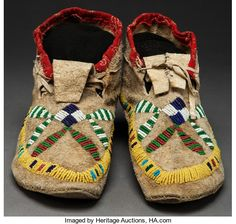 American Indian Art:Beadwork and Quillwork, A PAIR OF SIOUX BEADED HIDE MOCCASINS . c. 1900...