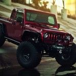 VWerks Red Jacket Jeep  Based on a 4-door Jeep Wrangler Unlimited, VWerks whacked off the rear and turned it into a Jeep pickup with a 50 inch bed (really, be subtle) and then added some elevation, huge rubber and a host of custom parts to bring the formerly capable Wrangler up to what we think of as the perfect vehicle for an Armageddon milk run.