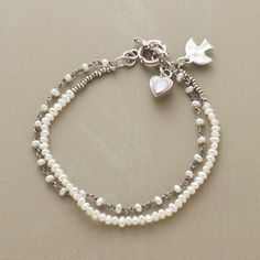 "PEARL ARTISTRY BRACELET -- Our exclusive two-strand bracelet intermingles cultured freshwater pearls with sterling links and seed beads. A mother of pearl heart dangles  from the toggle clasp. Handmade in USA. Approx. 7-1/2""L."