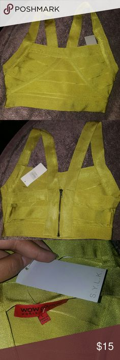 NWT Bandage top Lime green Bandage top from S.I.L.K. never wore but some how there is a mark near the right armpit area. WOW couture Tops