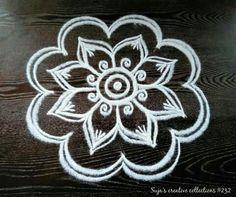 Rangoli designs awe-inspiring designs for your home Rangoli Designs Flower, Rangoli Patterns, Colorful Rangoli Designs, Rangoli Ideas, Rangoli Designs Diwali, Henna Designs Easy, Kolam Rangoli, Flower Rangoli, Beautiful Rangoli Designs