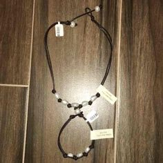 Leather and Pearls Bracelet Set NWT NEW WITH TAGS Leather and GENUINE freshwater pearls necklace and bracelet set. Retails for $65. Jewelry Necklaces