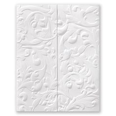 Deeply embossed swirls and filigree cover the front panels of this unique bright white tri-fold invitation. Your wording is featured inside.